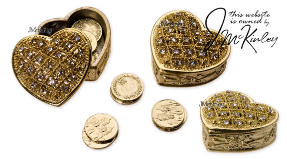 Heart with gold arras coins cz design on top and rose design on side Measures 2 x 2 X 5