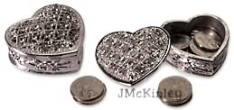 Heart with silver arras coins cz design on top and rose design on side Measures 2 x 2 X