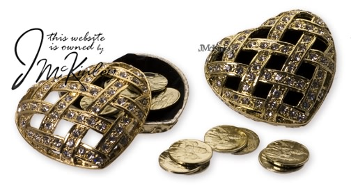 Heart with gold arras coins open cz design on top Measures 25 x 2 X 1H Quality feel