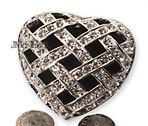 Heart with silver arras coins open cz design on top Measures 25 x 2 X 1H Quality feel