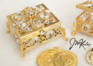 Shimmering Gold square arras box. Exquisite display of crystals and Czech rhinestones. Fits large or small coins. COINS SOLD SEPARATELY measures 2 3/4 L x 2 3/4 W x 1 3/4 H
