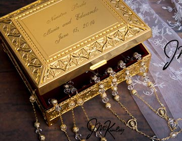 Large high polish and shiny gold plated lasso box is lined with Burgundy velvet