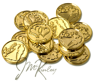 Gold wedding coins with Love and bride and groom silhouette on the front with double heart