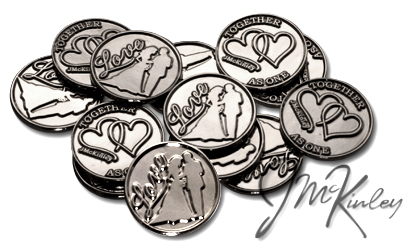 Silver wedding coins with Love and bride and groom silhouette on the front with double hea
