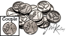 Silver wedding coins with Love and bride and groom silhouette on the front with double hearts and TOGETHER AS ONE on the back