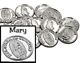 Silver wedding coins with Mary on front and praying hands on the back NTRA SENORA DE GUADALUPE. Recuerdo Matrimonial is a traditional saying on arras coins which translates as Wedding Souvenir or Marriage Memory
