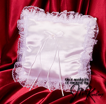 White square wedding ring pillow with sewn lace border