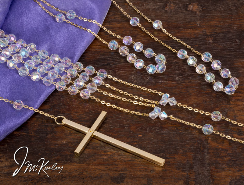 Crystal lazo with cross and gold accents